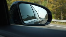 Close-up Side-view Mirror Refl...