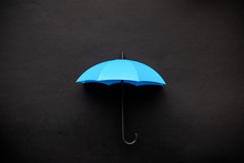 Blue Umbrella 3D Icon Isolated On Black Background