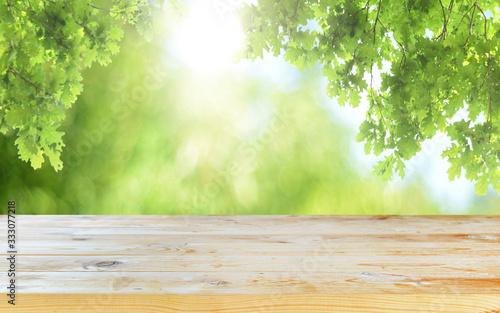 Fototapeta Empty wooden table background with spring background obraz na płótnie
