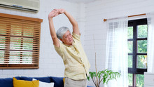 Senior Man Exercise At Home, H...