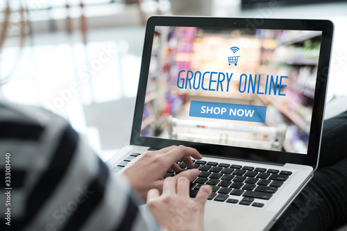Grocery online shop to order food delivery from supermarket, Woman hands using laptop computer for shopping grocery store online, electronic marketing, e commerce business concept