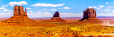 Panorama view of the sandstone formations of East and West Mitten Buttes and Merrick Butte in Monument Valley Navajo Tribal Park in southern Utah, United States