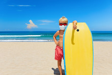 Young Surfer Wearing Sunglasse...