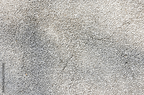 Exposed aggregate concrete in closeup made of small pebbles in different grey co Canvas Print