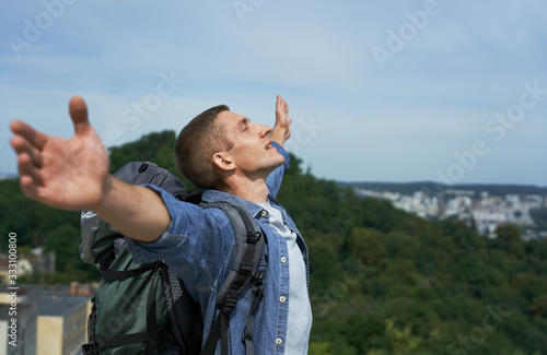 Fototapeta happy young tourist climbs the mountain obraz na płótnie