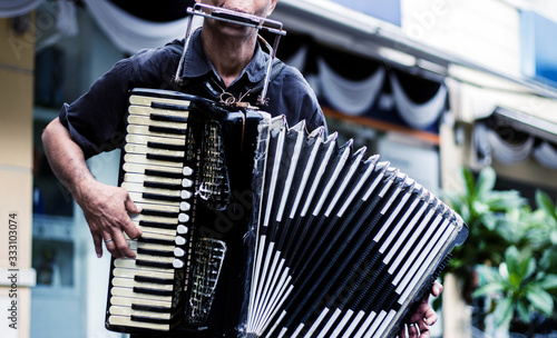 Fotomural close up musician playing accordion show on street