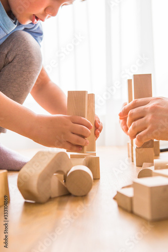 Young dad play with building bricks with small son Canvas Print