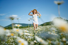 Girl In A Field With Flowers. ...
