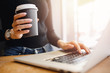 Leinwanddruck Bild - Young female businessman conducts business online computer home with coffee mug, while quarantine from coronavirus in country