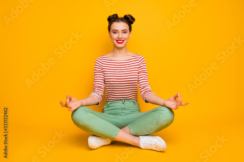Full length photo of funny lady hold fingers together sit floor legs crossed lot Wallpaper Mural