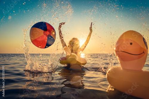 Happy child having fun on summer vacation Canvas-taulu