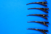 Hair Clips On A Blue Backgroun...