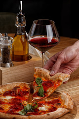 Fototapeta Do pizzerii pepperoni pizza and a glass of wine