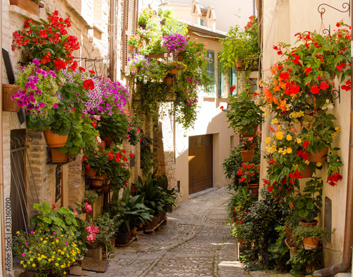Fototapety, obrazy: Medieval street of Spello decorated with flowers, Umbria, Italy