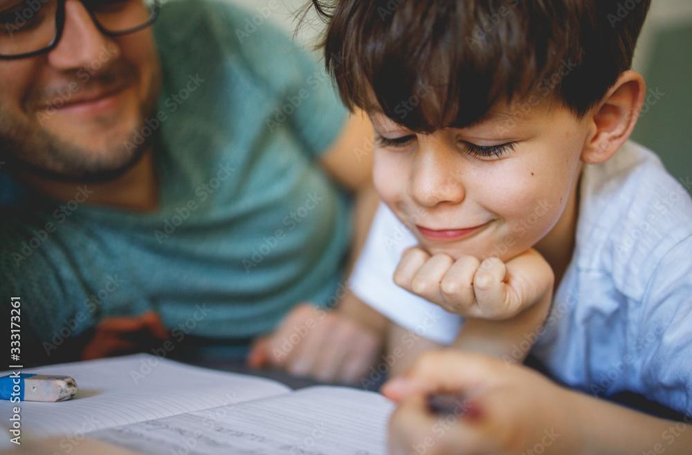 Fototapeta Father homeschooling his son
