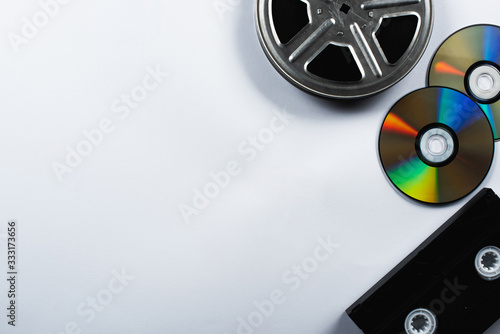 top view of CD discs, VHS cassette and film reel on white background Canvas-taulu