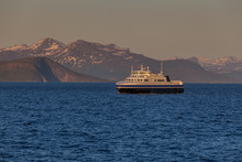Ship Sailing On The Blue Water Of The Norwegian Fjords In Polar Day, Midnight Sun. The Photo Was Taken At 2:00 At Night.