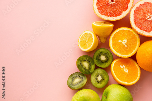 Fototapeta Fruits containing vitamin c on a pink background obraz