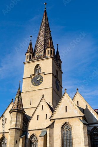 Fotografie, Obraz Church tower against blue sky