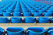 Empty Bleachers And Chairs In ...