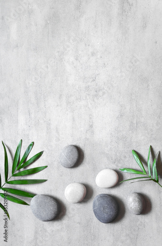 Fototapety Spa   grey-spa-background-spa-concept-palm-leaves-and-grey-stones-top-view