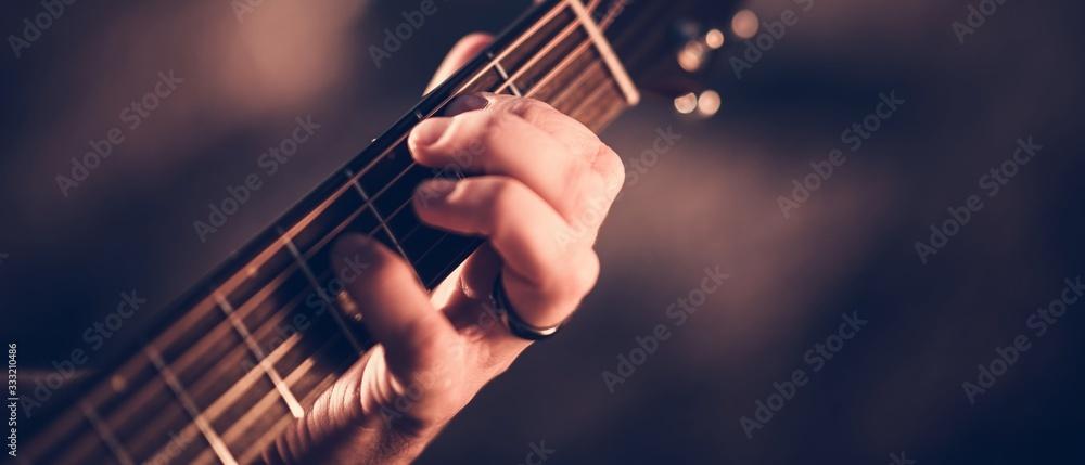 Fototapeta Hand on Guitar Neck