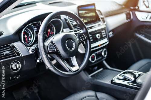 Stampa su Tela Interior view of car, Luxury car steering wheel and clean dashboard with display or monitor screen