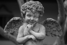 Stucco Doll, Cupid, The God Of Conveying Love In Western Beliefs
