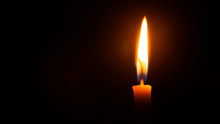 Close Up Single Candle Light A...
