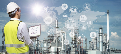 Obraz Industry 4.0 of oil and gas refining process of refinery plant, Double exposure of engineer working, Industrial energy system network icons concept. - fototapety do salonu