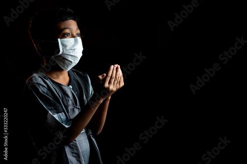 Muslim Boy Wearing a surgical mask Praying Wallpaper Mural