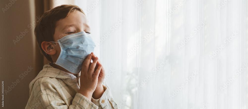 Fototapeta Coronavirus covid-19. Child praying to God requesting that the coronavirus covid 19 not spread beyond control.