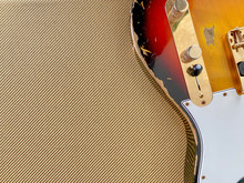 Sunburst Relic Electric Guitar Made From A Genuine Alder Wood On Tweed Background With Copy Space For Letter. Business And Music Concept. Wallpaper Or Background.