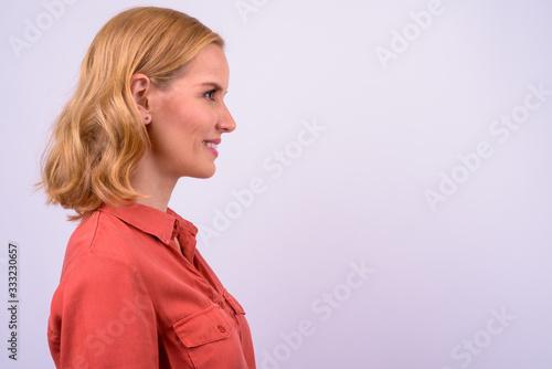 Fotografie, Obraz Closeup profile view of happy beautiful blonde businesswoman smiling