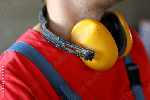 Valokuva On neck builder hang yellow soundproof headphones