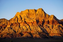 Impressive Red And Orange Rocks Contrast Against A Clear Blue Sky, Las Vegas, NV, USA