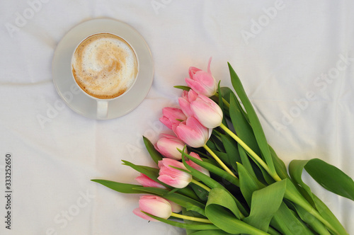Fototapeta cup of coffee and bouquet of tulips on white background obraz na płótnie