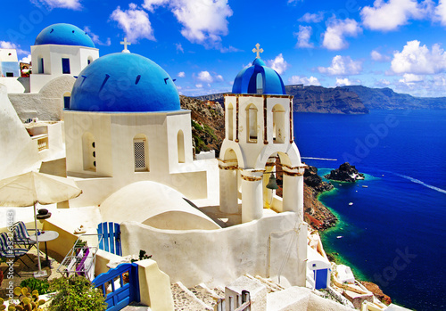 Fototapeta Iconic Santorini - most beautiful island in Europe. view with traditional churches in Oia village. Greece obraz