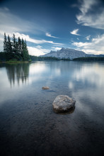 Two Jack Lake With A Pine Trees Island In The Morning With Beautiful Reflections And Blue Sky, Banff National Park, Canadian Rockies, Alberta, Canada, North America