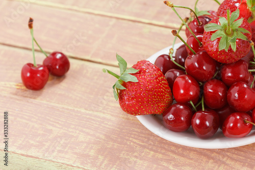 Fruit background, cherry and strawberry, copy space