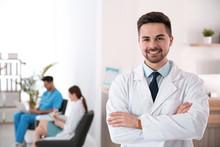 Portrait Of Male Doctor In Modern Clinic