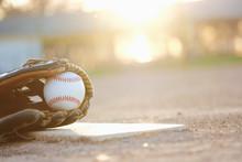Baseball Glove And Ball On Fie...