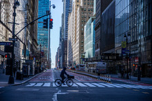 A Person Rides His Bike Through The Near Empty Streets Near Grand Central Due To Health Concerns To Stop The Spread Of Coronavirus In New York City On Tuesday, March 24, 2020. (Photo: Gordon Donovan).