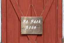 Be Back Soon, Old Weathered Wooden Sign Hang On A Barn Door