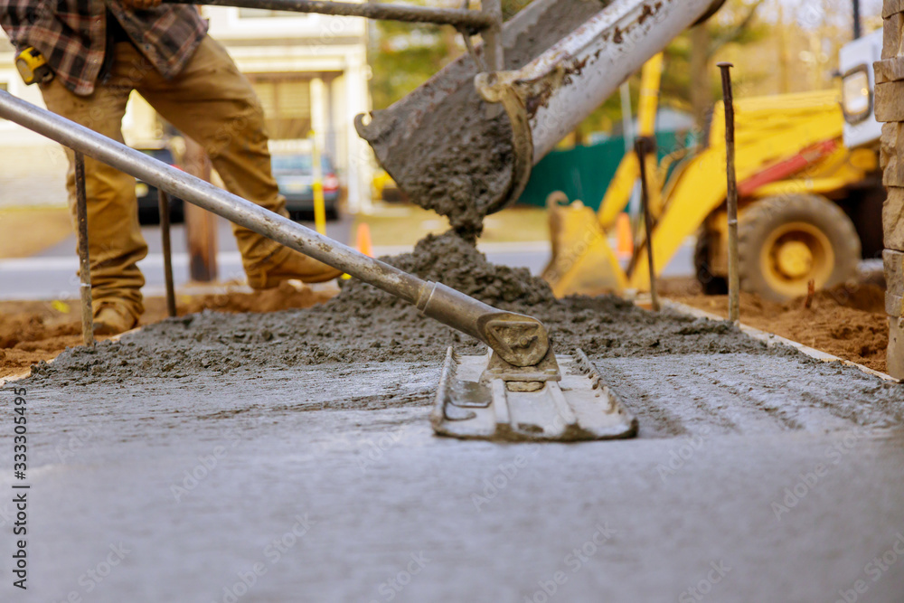 Fototapeta Worker working for concrete pavement for ground construction