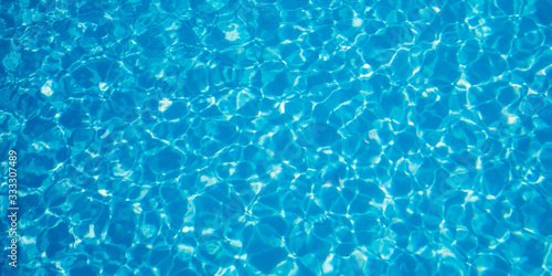 Fotografia Abstract ripped water in swimming pool with blue radial texture ripples backgrou