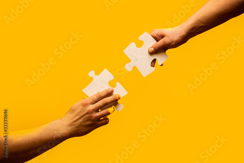 Closeup hands of man connecting jigsaw puzzle Tableau sur Toile
