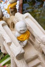 Monk Statue On Bridge.