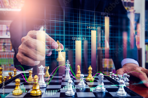 Chess game on chess board on stock market or forex trading graph chart for financial investment concept. Economy trends for digital business marketing strategy analysis. Abstract finance background.