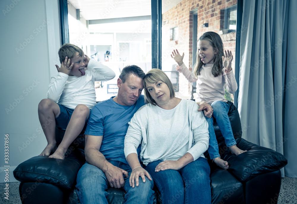Fototapeta Coronavirus Outbreak self isolation. Stressed Parents struggling with kids at home in quarantine